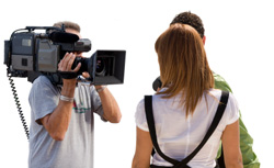 picture of cameraman filming a young couple